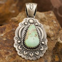 This beautiful Sterling Silver Pendant features Carico Lake Turquoise, exhibiting the green hues characteristic of this stone. Crafted by Native American artists. Colors may vary due to computer monit