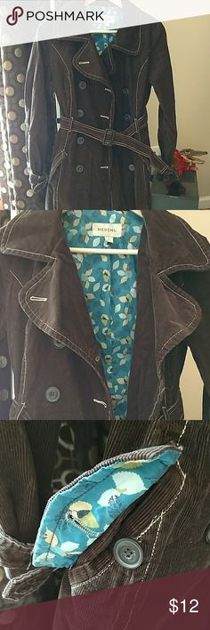 """$5 SALE!!!  Merona brown cotton corduroy jacket Woman's brown cotton corduroy jacket. Dark brown shell. Flowered teal pattern inside. Button down. Belted waist and sleeves. Size Small. This goes slightly below my knees and I'm 5'5"""". Very nice used condition! I will steam clean before I ship 😊 Merona Jackets & Coats"""