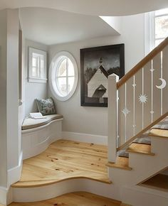 Traditional Staircase with Celestial cutouts stair railing, Hardwood floors, Window seat, Stair landing