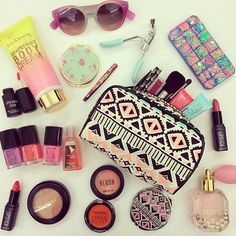 Make-up, lip-stick, sunglasses, makeup bag, nail polish, iPhone case, perfume, eye lash curler, blush  Yes please!