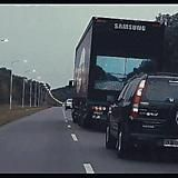 Putting a camera on the front of a truck with a TV on the back so you can see when to pass. - Imgur