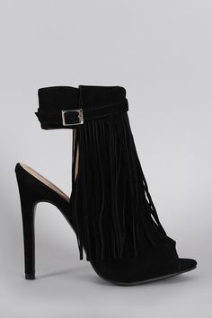 """Description This peep toe  fringe  along the front. Features an adjustable buckle strap and an inner adjustable side zipper. Finished on a stiletto heel.Material: Vegan Suede (man-made)Sole: Synthetic  Measurement Heel Height: 5"""" (approx)Shaft Length: 8.5"""" (including heel)Top Opening Circumference: 7"""" (approx) 