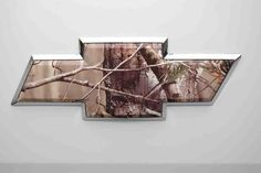 Realtree camo Chevy bow tie. I'm going to need this for my truck!!!