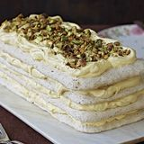 Pistachio-flecked meringue layers contrast a tangy, creamy lemon curd filling in this stunning dacquoise. Perfect for a special occasion, this make-ahead dessert needs at least 24 hours in the refrigerator before serving to soften a bit. Pavlova, Make Ahead Desserts, Just Desserts, Meringue Desserts, Gourmet Desserts, Lemon Desserts, Plated Desserts, Sashimi, Dacquoise Recipe