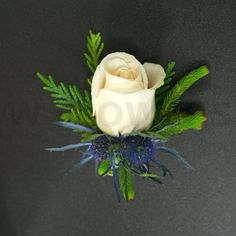 W Flowers product: Winter Wedding Boutonniere with Blue Eryngium