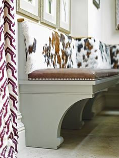 This bespoke bench features curved support brackets and cushions upholstered in leather and pony hide. West London kitchen designed by Matt Podesta, podesta.uk.com | Homes & Gardens | http://www.hglivingbeautifully.com/2016/04/18/dream-rooms-a-smart-west-london-kitchen/