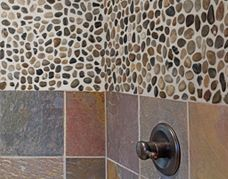 The smooth natural stones are offered in both round and flat surfaces in a size and perfectly suitable for floor and wall installations. Flooring Store, Tile Flooring, Pebble Stone, Stone Tiles, Pebble Mosaic, Floor Ceiling, Wall Installation, Kitchen And Bath, Backsplash
