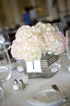 Simple hydrangea centerpiece. Ribbon with table numbers