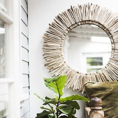 Two layers of hand-selected California driftwood adorn this mirror with dimension, natural tones and coastal character. Sunburst diameter is