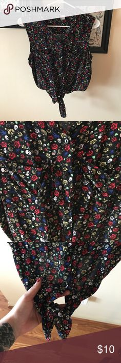 Tattoo Print Button Up Tank Tattoo-like designs on a black, button up, collared shirt with a front tie at the bottom. Two pockets on the chest. Great condition Divided Tops Button Down Shirts