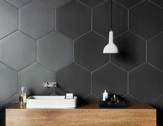 Bathroom Tile Ideas - Grey Hexagon Tiles // Large hexagonal charcoal tiles on the walls of this bathroom create a unique, modern look that compliments the wood countertop and contrasts the white sink and light fixture. Hexagon Tile Bathroom, Black Hexagon Tile, Hexagon Tiles, Bathroom Flooring, Hex Tile, Honeycomb Tile, Tiling, Grey Bathrooms, White Bathroom