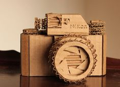 Fantastic round-up on Etsy of cardboard craft tutorials, and links to some Etsy awesomeness, if you're inclined more to shopping than crafting. This Nikon is for sale.