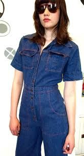 Denim Jumpsuits...Hate to admit it, but I had one.  Actually, she looks really cool, kind of like Joan Jett.