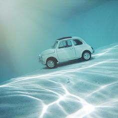 Summer is here... Props to my brother @sebastianbrent for the underwater phone #fiat #underwater #toy #car #water #fiat500 #summer #swim #modelcar #fiatfun