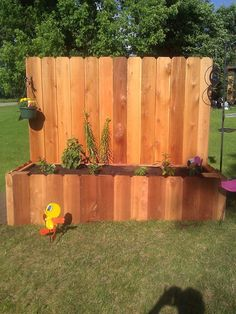raised flower bed... a way to reuse the fence when we sink that pool!
