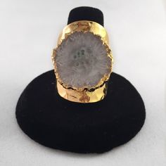 White druzy stalactite cuff ring Beautiful 24k hammered cuff ring with white druzy stalactite. Size is an 8. It is not very adjustable but can be worn on any finger. Jewelry Rings