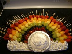 My Rainbow Fruit Kabobs on a cloud of marshmallows and whipped cream.     Created by C. Browne  Ingredients order per skewer:  Strawberry, Cantaloupe, Pineapple, Green Grape, Blueberries x2, Red Grape.