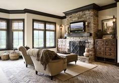 Well done Tuscan color scheme, light colored taupe walls accented by dark trim and stone work.