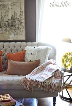 It is sweater season after all, so why not cover a cushion in cable knit? This look is extra cozy, and with plaid and other burnished hues, the seasonal look is complete. Click through for more on this and other fall home decor ideas.