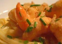 Scampi in romige currysaus met pasta of brood