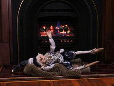 We found our mate Commander escaping the chilly Melbourne weather. Here he is lying on a bear skin rug next to a roaring fire! What a clever little bub! 🔥 #rtcelves #christmaself #elf #elves #australianchristmas #relax #chillout