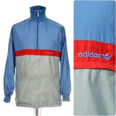 Concealed nylon hood, knitted collar and cuffs, one zipped kangaroo pocket. Vintage Windbreaker, Windbreaker Jacket, Tracksuit Tops, Vintage Adidas, Collar And Cuff, Adidas Jacket, Sportswear, Jackets, Shopping