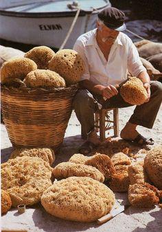 Greek sponge man in Kalymnos, large even holes in the sponge makes it last longer and wash in vinegar!