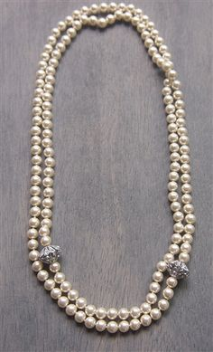 No grit, no pearls.  This is a vintage inspired pearl strand necklace.  The long strand lends itself to give you options on how to wear it, tie to in a knot, loop it around your neck, or wear it long!  Vintage Fob Pearl Necklace