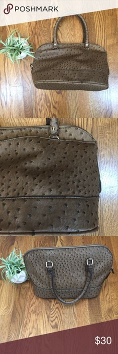 Vintage London Fog Purse Good condition. Well taken care of. It hangs at 15 inches, the width is 14.5 inches, and the width across the bottom is 7 inches. I'm open to offers. London Fog Bags