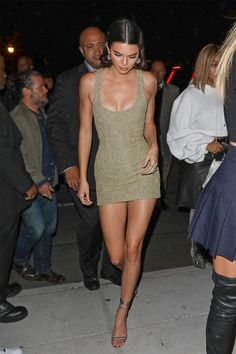 Kendall Jenner was spotted arriving at the Mert Alas x Marcus Piggott book launch party at Public in New York wearing a golden mini dress.