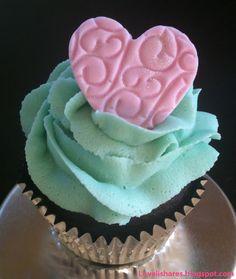 Buttercream rose swirl with an embossed fondant heart.