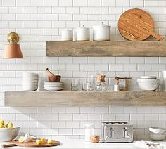 Save space and stay organized with wall shelves and floating shelves from Pottery Barn. Find wood, metal and glass shelves in various styles to complete your space. Floating Shelves Kitchen, Glass Shelves, Wood Shelves, Open Kitchen Shelving, Pottery Barn Shelves, Pottery Barn Kitchen, Corner Shelves, How To Make Floating Shelves, Diy Kitchen Shelves