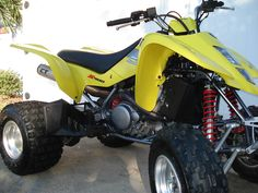 Maxxis Razr rear tires and other suzuki ltz 400 parts