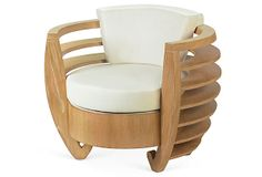 Curva Chair, Beige  on OneKingsLane.com.  A modern interpretation of the classic tub chair, this piece boasts a rounded, exposed-wood frame and cotton-covered cushions.