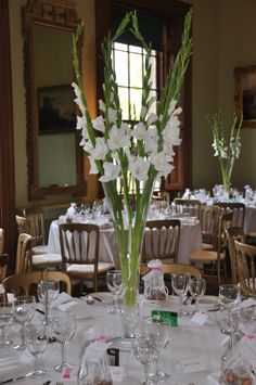 Gladiolus in a white wedding, by Beautiful Flowers Northampton . Gladiolus in a white wedding, by Beautiful Flowers Northampton More. Tall Wedding Centerpieces, Wedding Flower Arrangements, Floral Centerpieces, Floral Arrangements, Wedding Decorations, Centrepieces, Gladiolus Centerpiece, Gladiolus Arrangements, Gladiolus Wedding
