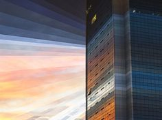 A glass building mirrors the sky in Singapore as the sun goes down over the city. (Photo by Fong Qi Wei/Thoughtful Photography)