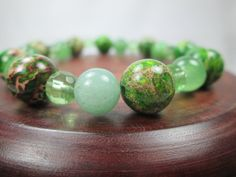 BEAUTIFULLY SIMPLE, THIS GREEN STONE, STRETCH, STACKABLE BRACELET IS LOVELY BY ITSELF OR CAN BE WORN WITH OTHER LIKE BRACELETS.  (SEE THE TWO GREEN BRACELETS LISTED BESIDE ...
