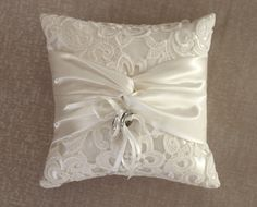 Ring bearer pillow Ivory Lace Ring Pillow. $45.00, via Etsy.