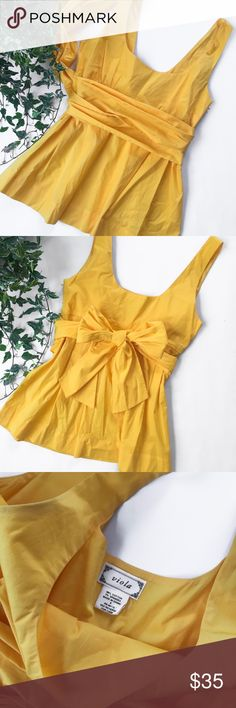 Viola by Anthropologie Yellow Wrap Top Viola by Anthropologie canary yellow wrap top. Scoop neck. Babydoll style blouse. Preowned. Excellent condition.   ✨Bundle to save! Offers welcome!✨ Anthropologie Tops Blouses