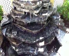 Waterfall made from leftover pieces of countertop that would have gone to the dump...