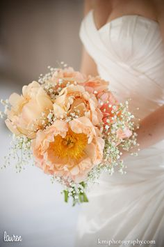Peach Peonies and Baby's Breath. Simple, pretty, more than pastel but not too bright if that's what one wants.