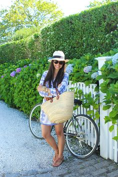 Fashion blogger Kat Tanita of With Love From Kat wore a Roberta Freymann dress on her travels in Nantucket. We love how she paired it with a big straw market bag and cute fedora to create a perfect summer outfit.
