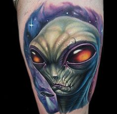 Amber Eyed Green Alien Tattoo Guys Arms