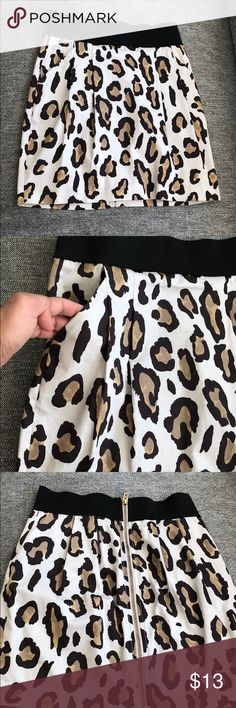 Armani Exchange short leopard skirt Super cute SHORT A/X short skirt. Worn only three times. The waist is a bit elastic, but not too much room for stretching. Wear with a t-shirt tucked in or with a tank top. Dress it up with heals or down with flip flops. Bought this piece at the Outlets, hence the price point and the red line through the label. Happy posting! Skirts Mini