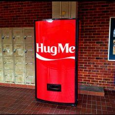 Coca cola hug machine 1 hug 1 coke because vending machines have