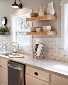 Who's still up?  I drank tea too late tonight and now I'm all so I'm on Pinterest trying to decide what color I want to paint my kitchen. I'm leaning towards SW Mindful Gray or a color like SW Sea Salt. Ugh!  I can't decide!!  I'm loving the gray in this Fixer Upper kitchen!  What do you think?? Gray or a bluish-green gray color? :@magnolia . . #farmhouse #farmhousekitchen #farmhousestyle #paint #kitchen #kitchenstyle #decor #style #home #homeinspo #inspiration #fixerupper #inte...