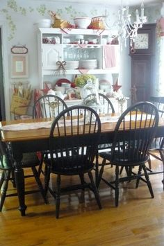 Like the contrast between the dark dining set and white cabinet. roomzaar.com