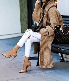 Camel knit cardigan with white jeans.