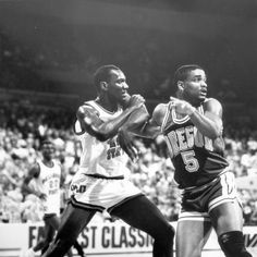 Black and white photo of University of Oregon basketball player Randy Grant jockeying for position against an Oklahoma State opponent during a game played at Memorial Coliseum in Portland on December 27, 1987 and won by the Ducks 68-55. ©University of Oregon Libraries - Special Collections and University Archives