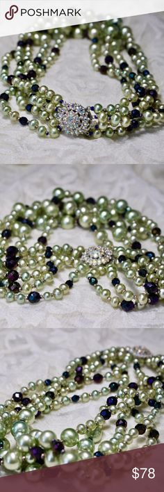 "🆕Green Pearl Rhinestone Statement Necklace 🔹Graduating green faux pearls and faceted purple & blue crystals on a 5 strand necklace.🔹Clasp is beautifully detailed in rhinestones so necklace can be worn in front or back.🔹18"".🔹Silver tone metal.🔹Excellent vintage condition.🔹No trades/off Posh transactions.🔹Reasonable offers welcome! Vintage Jewelry Necklaces"